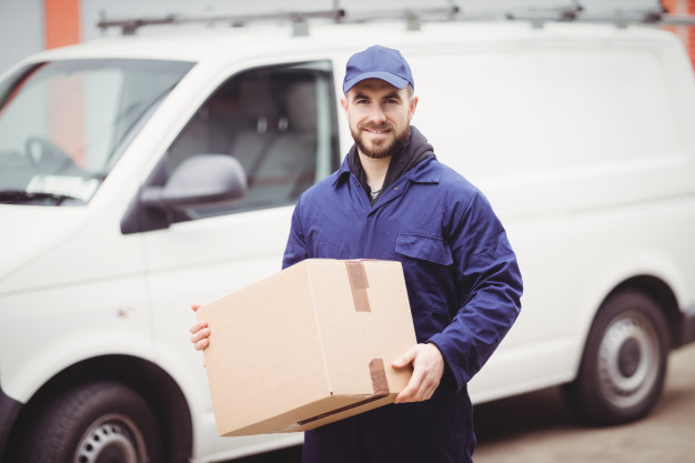 delivery-man-holding-box-front-his-van