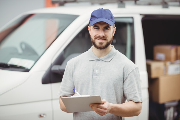delivery-man-writing-clipboard-front-his-van