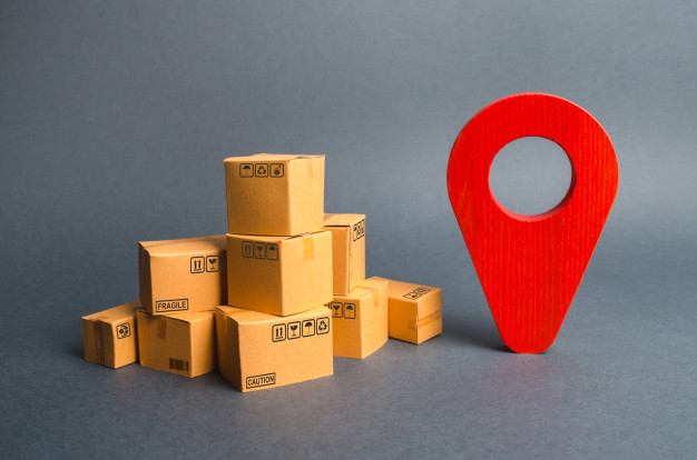 pile-cardboard-boxes-red-position-pin-locating-packages-goods